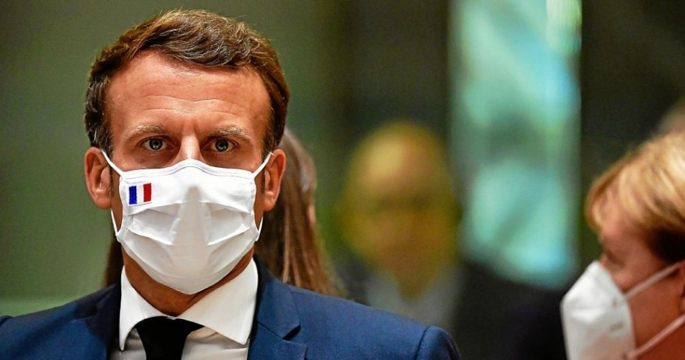 emmanuel macron bär mask frankrike